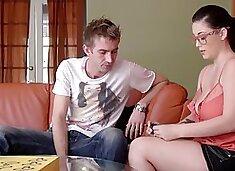 Nerdy girl with big jugs has fun with friend`s big bulge