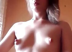 Slim blonde with small tits coaxes some milk out of her puf