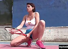 Girl spreads her legs on a tennis court for a masturbating session